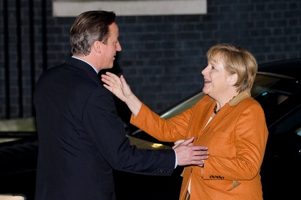 Not as close as they seem... David Cameron and Angela Merkel look set to collide over the EU budget. Image: Getty.