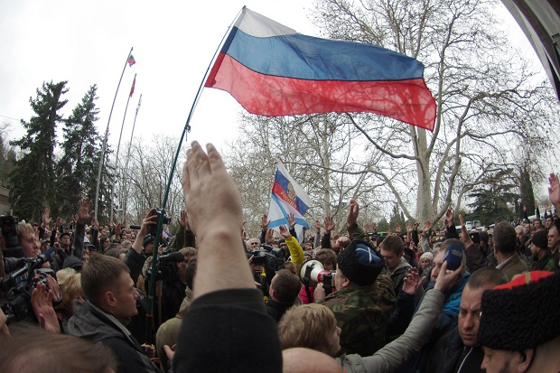 Pro-Russian protestors gathered in Sevastopol earlier today to oppose the change of government in Kiev. Former President Viktor Yanukovych, whose arrest has been sought by the new government, is understood to have fled to the Crimea. (Vasiliy BATANOV/AFP/Getty Images)