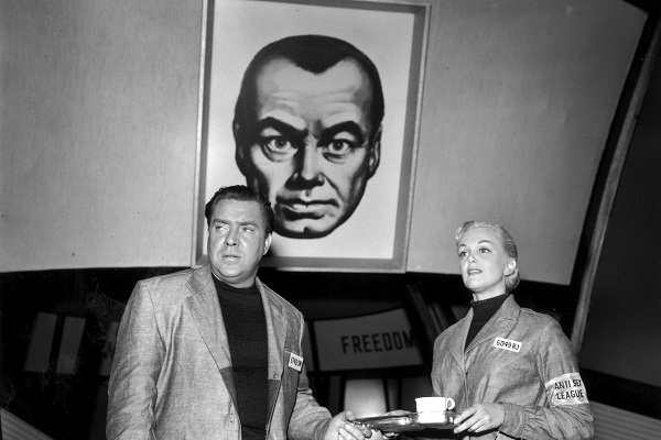 'Big Brother' watches over Winston Smith (Edmond O'Brien) and Julia (Jan Sterling), during the filming of the 1955 adaptation of '1984'. Image: Getty