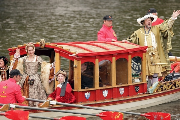 A man dressed as Henry VIII progresses up the Thames in search of more plenty. Image: Getty
