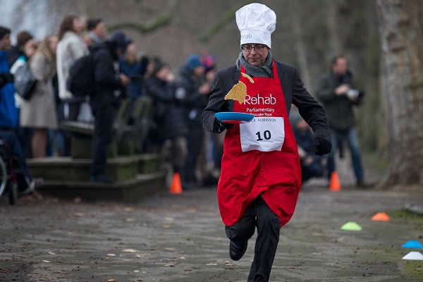 Nick Robinson taking part in the annual parliamentary pancake race earlier this year. (ANDREW COWIE/AFP/Getty Images)