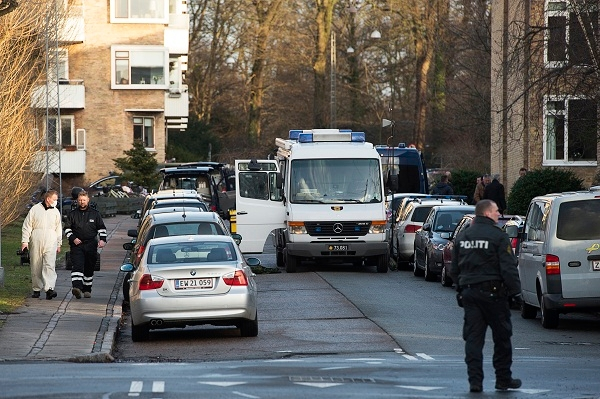 Policemen survey the area in Copenhagen where a man tried to shoot Lars Hedegaard earlier today. Image: Getty