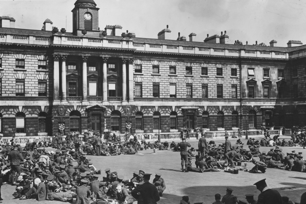 August 1914:  Men of the Territorial Force sit outside Somerset House during a recruitment drive (Photo: Topical Press Agency/Getty)