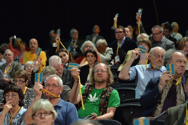 Lib Dem activists vote in a policy motion at their party conference in Brighton. Picture: Getty.