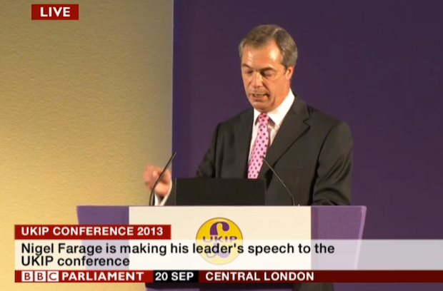 Eyes down! Farage mainly read his speech
