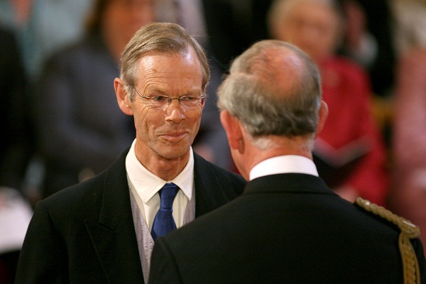 Christopher Martin-Jenkins receives the MBE from the Prince of Wales for services to cricket journalism. Image: Getty.