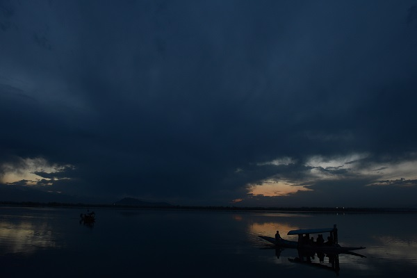Darkness falls over Dal Lake in Srinigar in Kashmir, scene of much of the non-sporting action of The Great Tamasha by James Astill and Cricket Cauldron by Shaharyar M. Khan. (TAUSEEF MUSTAFA/AFP/Getty Images)