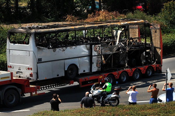 A truck carries the bus damaged by the suicide bomb blast which targeted a group of Israeli tourists at the airport in Bourgas, Bulgaria, on July 19, 2012. Image: Getty