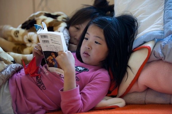 Even as a child, life is too short to turn the pleasure of reading into a chore. (Photo by Paula Bronstein /Getty Images)