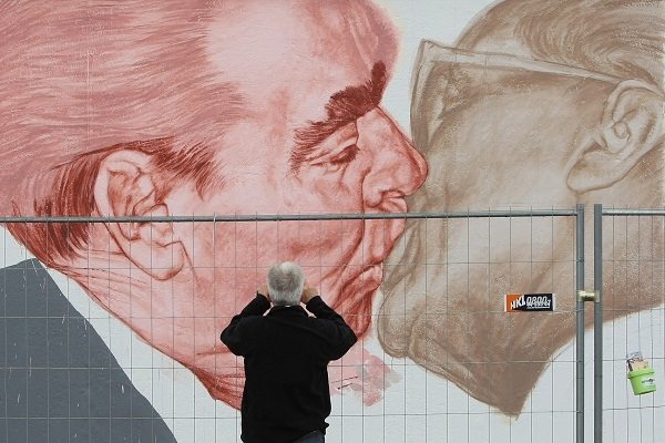 Dmitry Vrubel's picture of Leonid Brezhnev kissing Erich Honecker, whose rule provide the backdrop to Stefan Heym's 'The Architects' and indeed Heym's life. Image: Getty