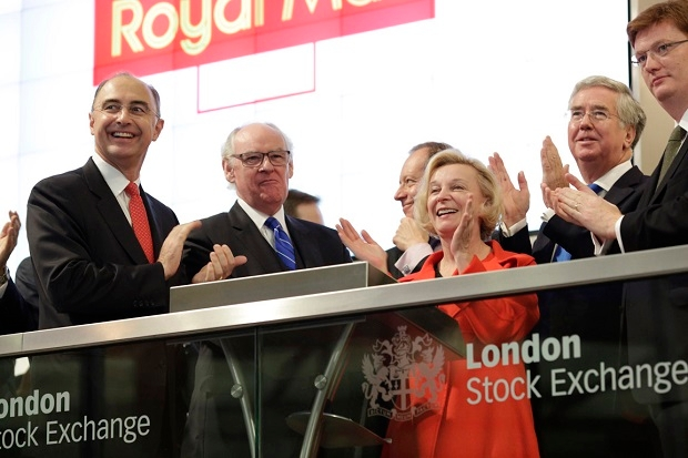 Michael Fallon (second right) at the launch of Royal Mail Plc last year. (Image: Royal Mail Group/Getty Images)