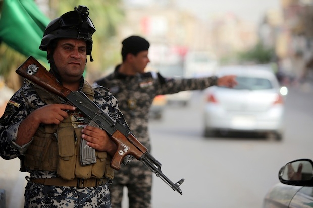 Iraqi policemen man a checkpoint in Baghdad. Image: Getty