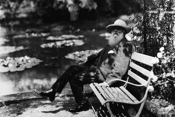 Claude Monet taking in the air and the water lilies in his garden at Giverny, circa 1910. Image: Getty