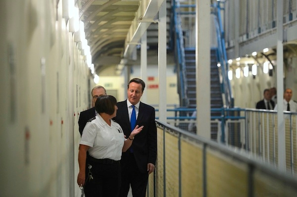 David Cameron on a visit to Wormwood Scrubs prison earlier this week. The Prime Minister today confirmed he will oppose attempts to give prisoners the vote. Picture: Getty
