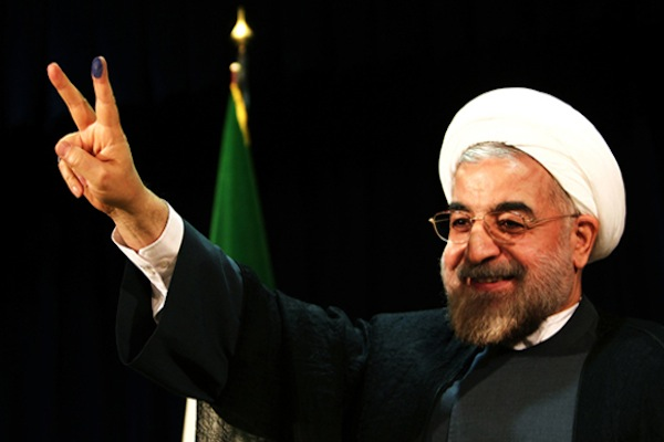 IRAN BREW: Hassan Rouhani, showing Iranians a version of a gesture he learned in Glasgow.