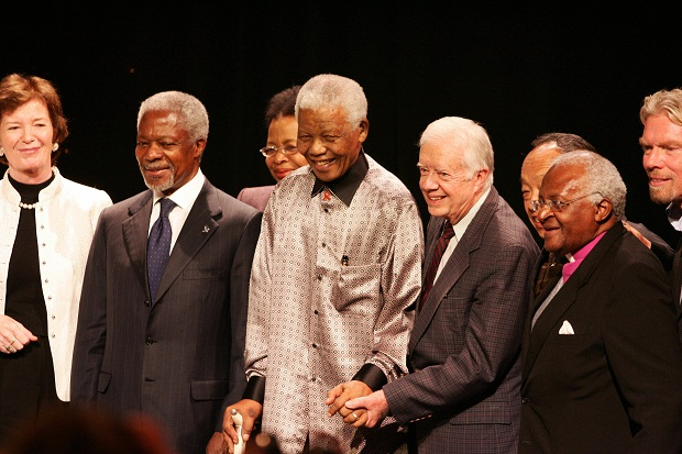 Johannesburg, SOUTH AFRICA: Nelson Mandela (C), celebrating his 89th birthday, stands flanked by ex-US president Jimmy Carter (3R) former UN chief Kofi Annan (1L), Archbishop Desmond Mpilo Tutu (1R) and Richard Branson (R) during the launching ceremony of the group known as The Elders 18 July 2007 in Johannesburg. (Photo credit should read ALEXANDER JOE/AFP/Getty Images)