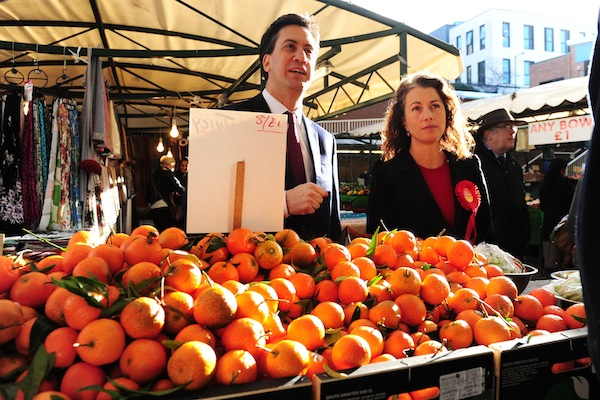 Ed Miliband and Sarah Champion, Labour Party candidate for the forthcoming Rotherham by-election, talk to stallholders during a visit to Rotherham Market. Picture: PA