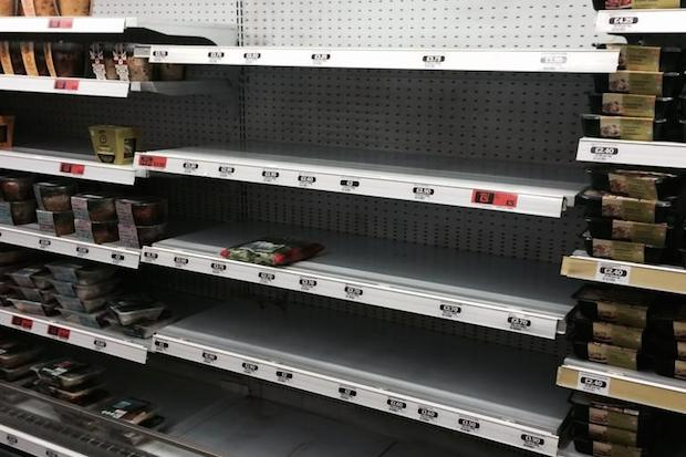 Shelves in Sainbury's, Holborn, emptied of kosher foods. Image: Colin Appleby