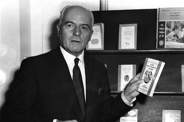 Sir Allen Lane, founder of Penguin, posing with a copy of Lady Chatterley's Lover in 1960.