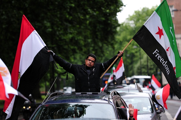 A demonstrator supporting Egypt's ousted Islamist president Mohamed Morsi drives through London earlier this autumn.