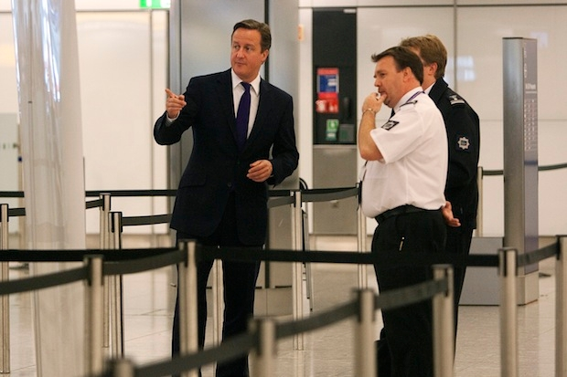David Cameron talking to border officials. Image: Getty