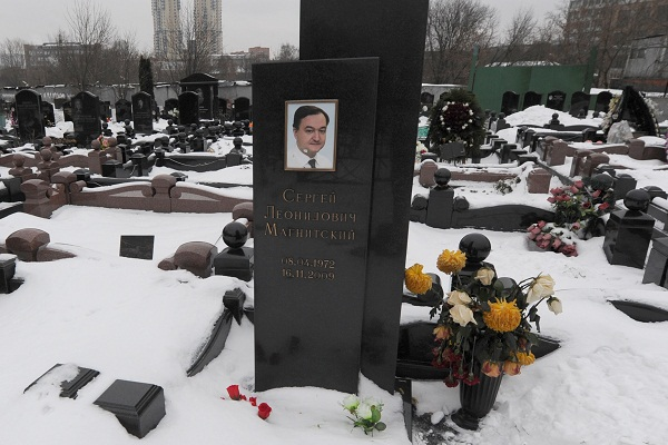 A picture taken on December 7, 2012, shows  snow clad grave of Russian lawyer Sergei Magnitsky with his portrait on the tomb. Picture: ANDREY SMIRNOV/AFP/Getty Images