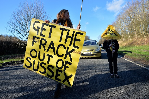 Anti-fracking protestors outside Balcombe in West Sussex earlier this year. (AFP PHOTO/BEN STANSALL)