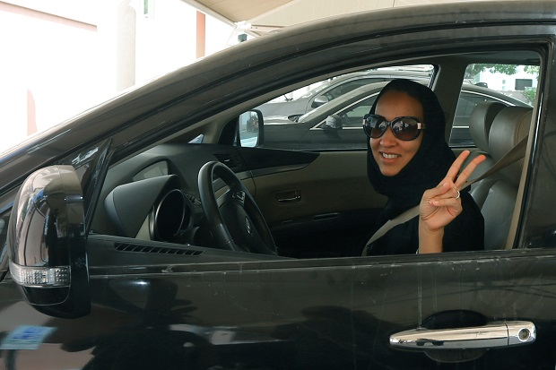 Saudi activist Manal Al Sharif, who now lives in Dubai, flashes the sign for victory as she drives her car in the Gulf Emirate city on October 22, 2013, in solidarity with Saudi women preparing to take to the wheel on October 26, defying the Saudi authorities, to campaign women's right to drive in Saudi Arabia. (MARWAN NAAMANI/AFP/Getty Images)