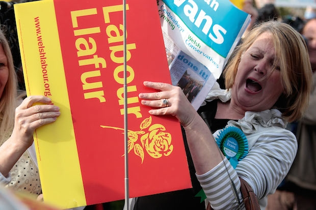 Labour and Conservative supporters' placards, held on the occasion of a visit by Gordon Brown to Cardiff during the 2010 election campaign. Image: Getty