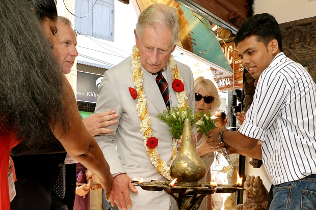 Prince Charles gets too close to the 65 candles (Photo: John Stillwell/Pool/Getty)