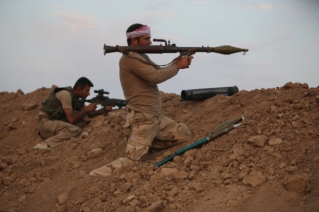A Peshmerga fighter waits on the Isis front line. Image: Getty