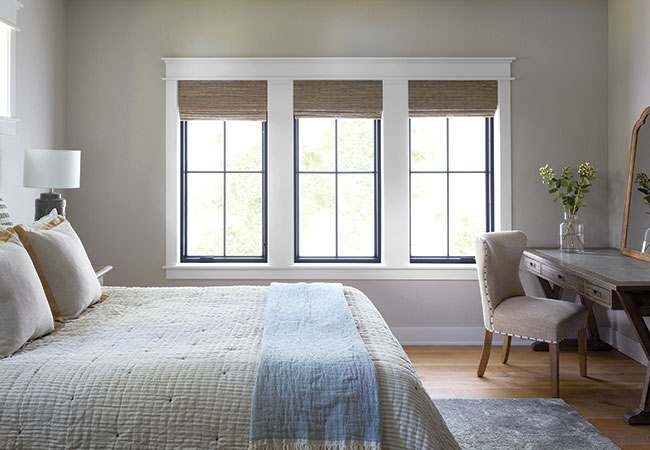 Bedroom with 3 fixed frame rectangular windows.