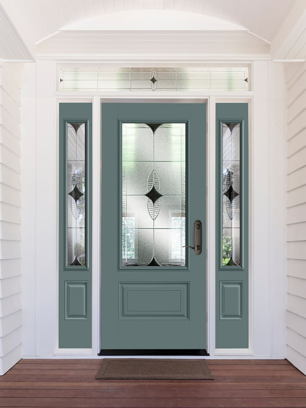 front entry door with decorative glass and dual sidelights in a white home