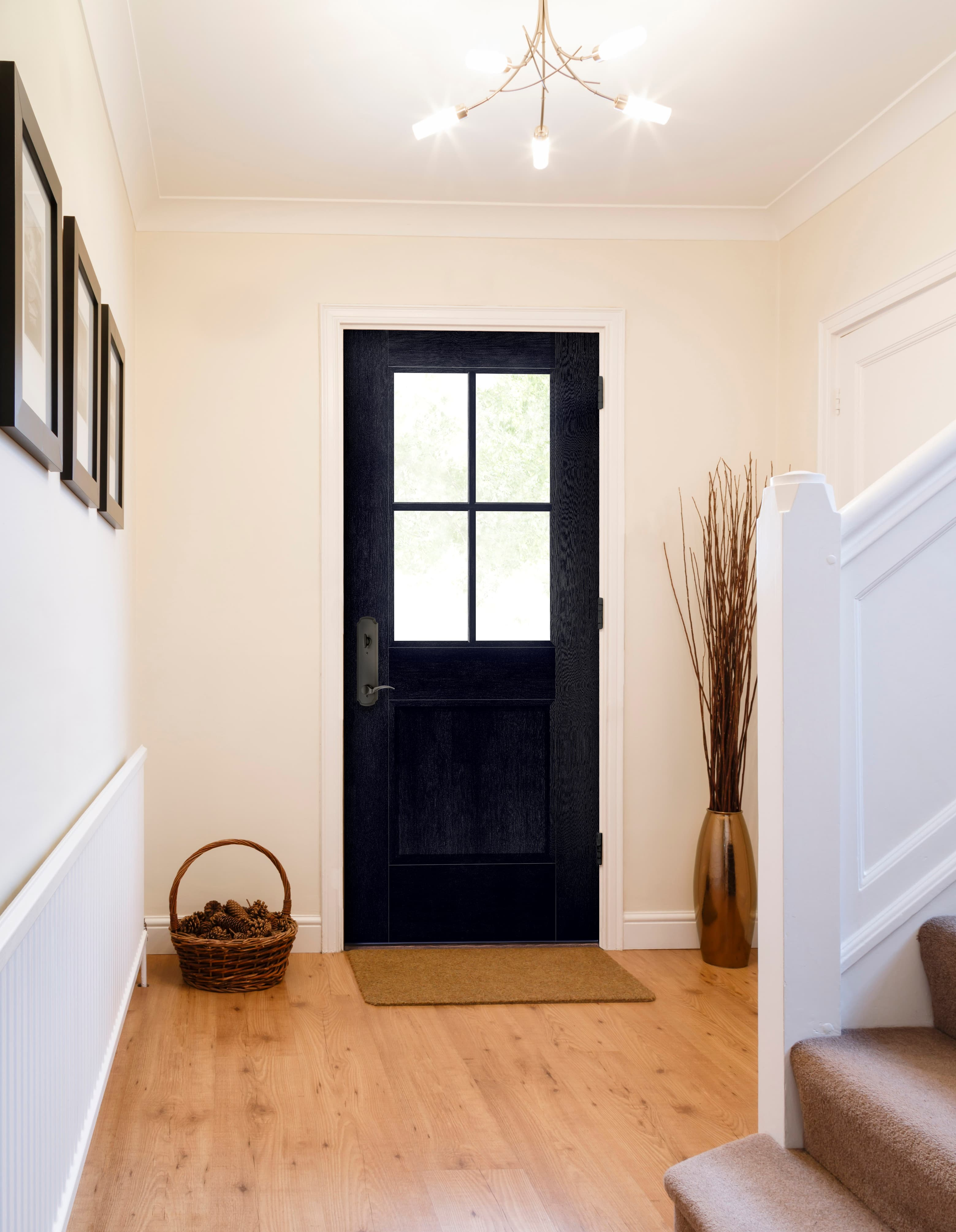 Black front door with classic grilles in farmhouse style entry