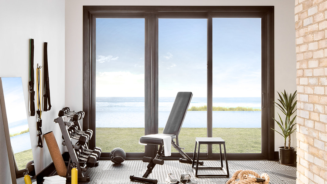 home gym equipment with three-panel impervia patio door