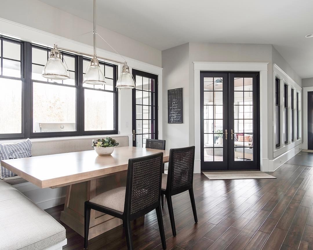 double-hung windows and french doors bring light into contemporary breakfast nook