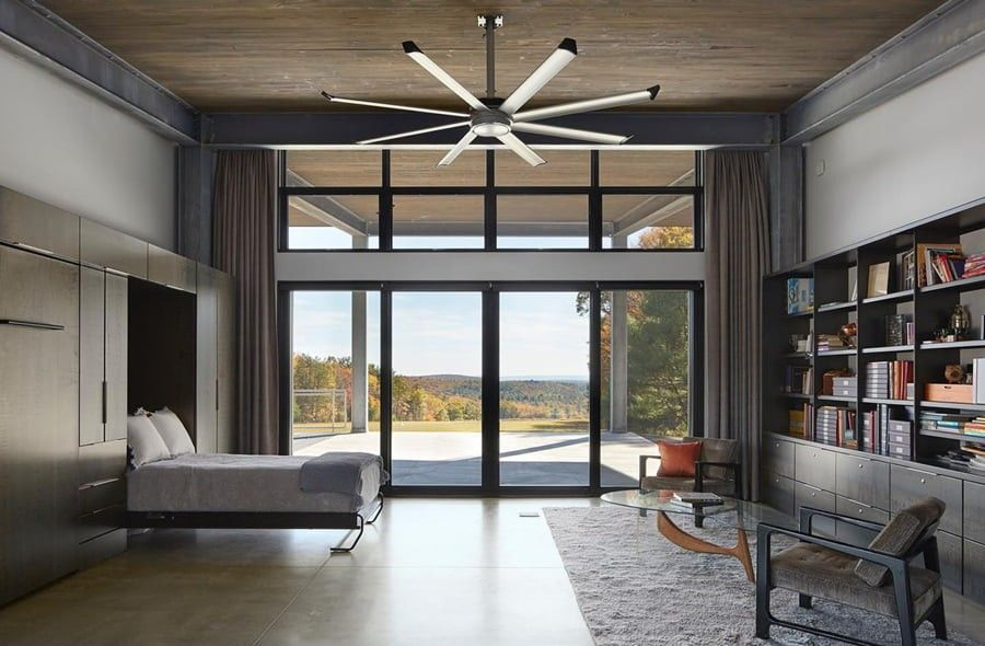 Black patio doors in a bedroom with a landscape view