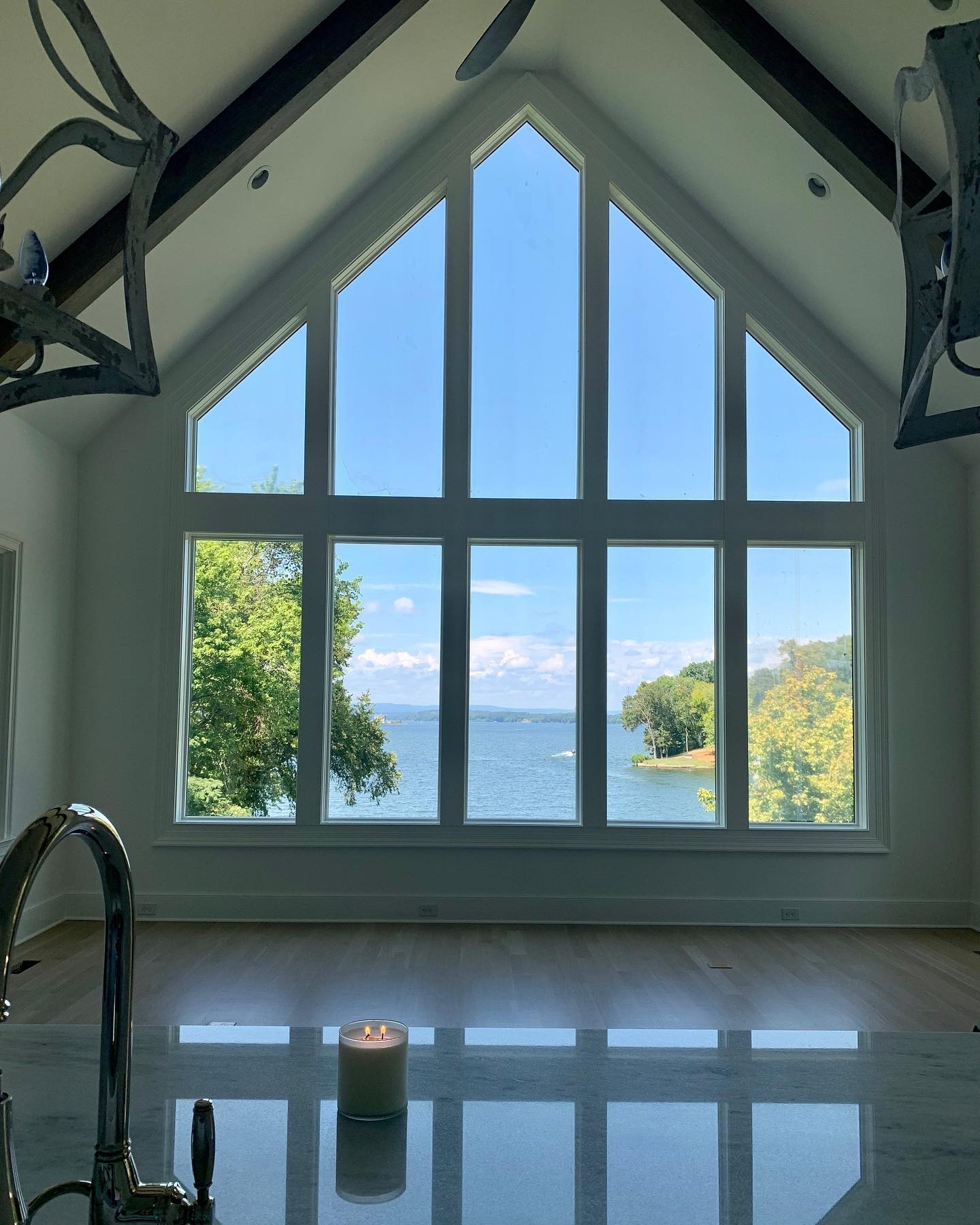 Custom window wall frames the beautiful outdoor view