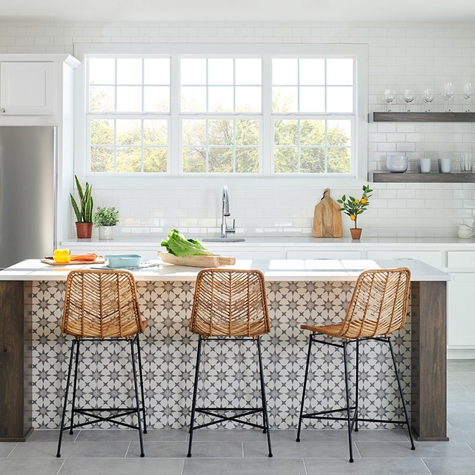 contemporary kitchen with patterned tile and three barstools