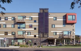 Curb view of The Rose multifamily housing development.