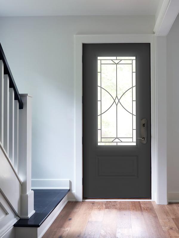 interior of black front door with decorative glass