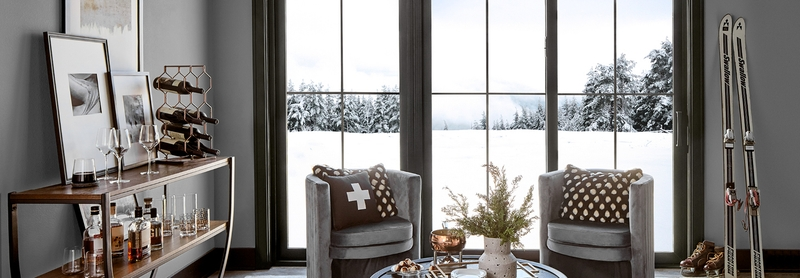 cozy living space with black sliding doors and winter scene