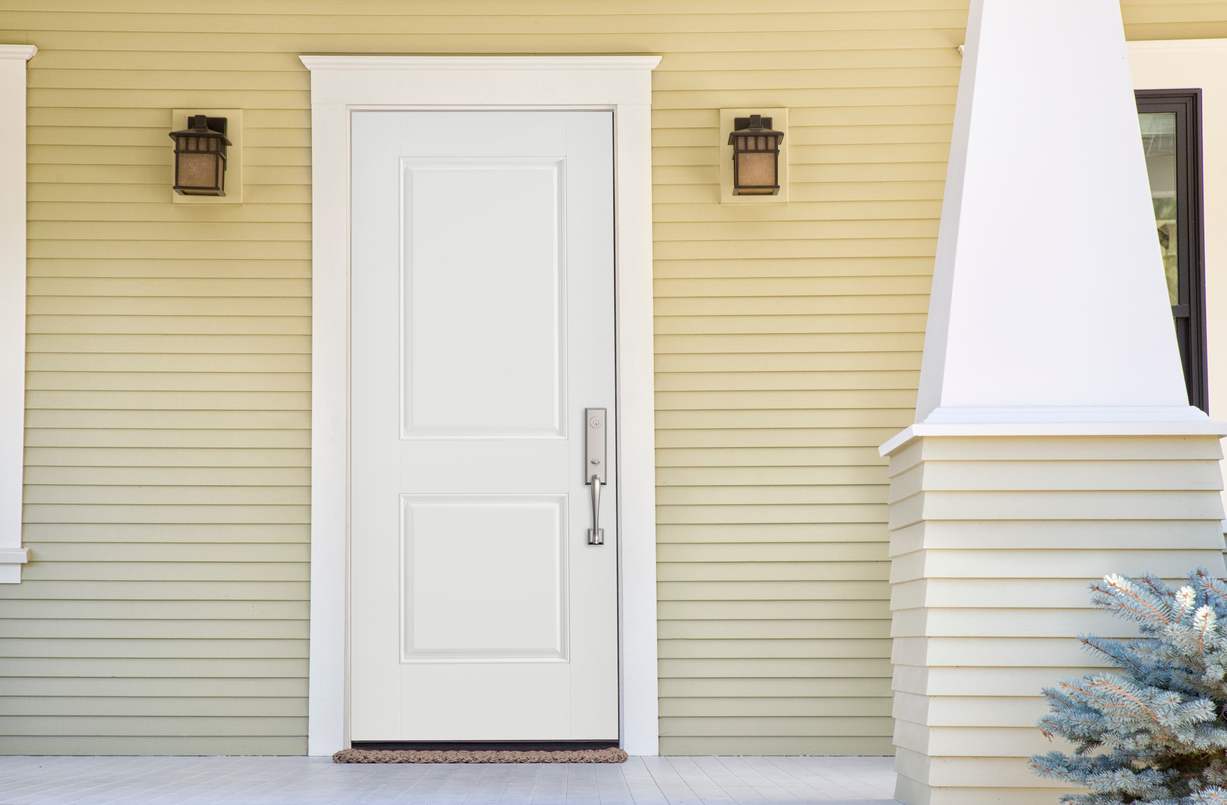 Stylish steel door surrounded by traditional trim and clapboard siding