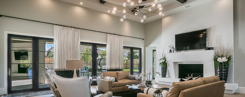 Row of three black french doors in modern style living room