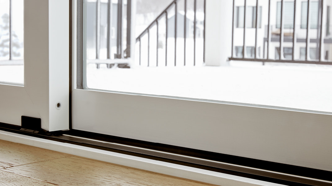 a pella impervia sliding door closed with a low sill