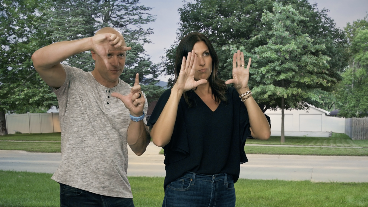 Two people estimating their house with their hands and imagining their possibilities