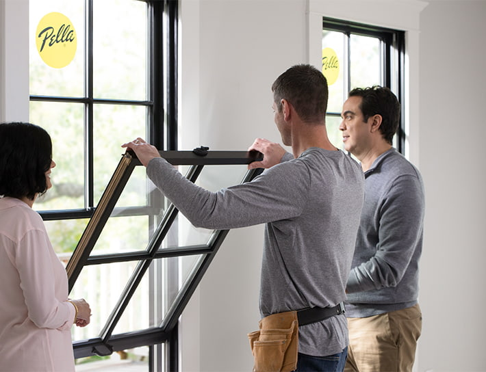 two commercial pros working on a double-hung window
