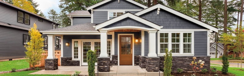 traditional home at night with a wood pella entry door in the front