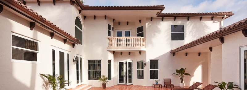 exterior home in tropical region with hurricane shield windows