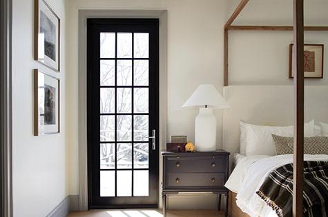 single black hinged door traditional grilles